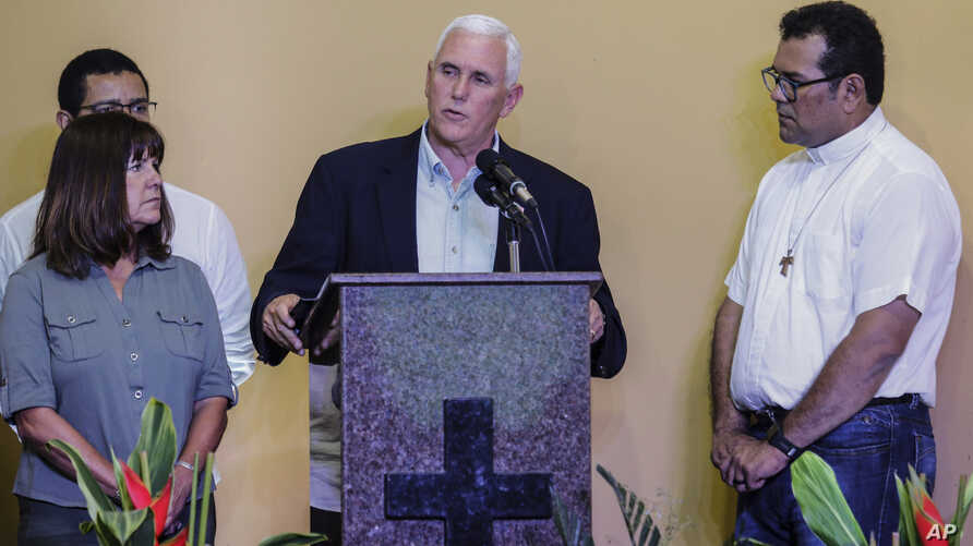 U.S. Vice President Mike Pence, center, accompanied by his wife Karen, left, speaks after a meeting with Venezuelan families at the Santa Catarina migrant shelter, in Manaus, Brazil, June 27, 2018.