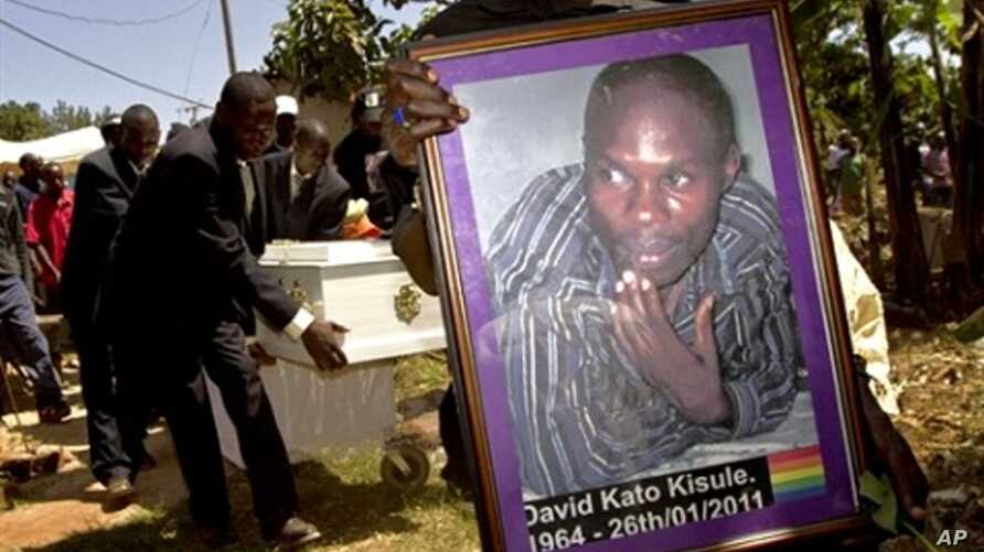 A member of the Ugandan gay community carries a picture of murdered gay activist David Kato during his funeral near Mataba, January 28, 2011.  Although the police claims it was most likely a petty crime, targeting Kato's money, many members of the ga