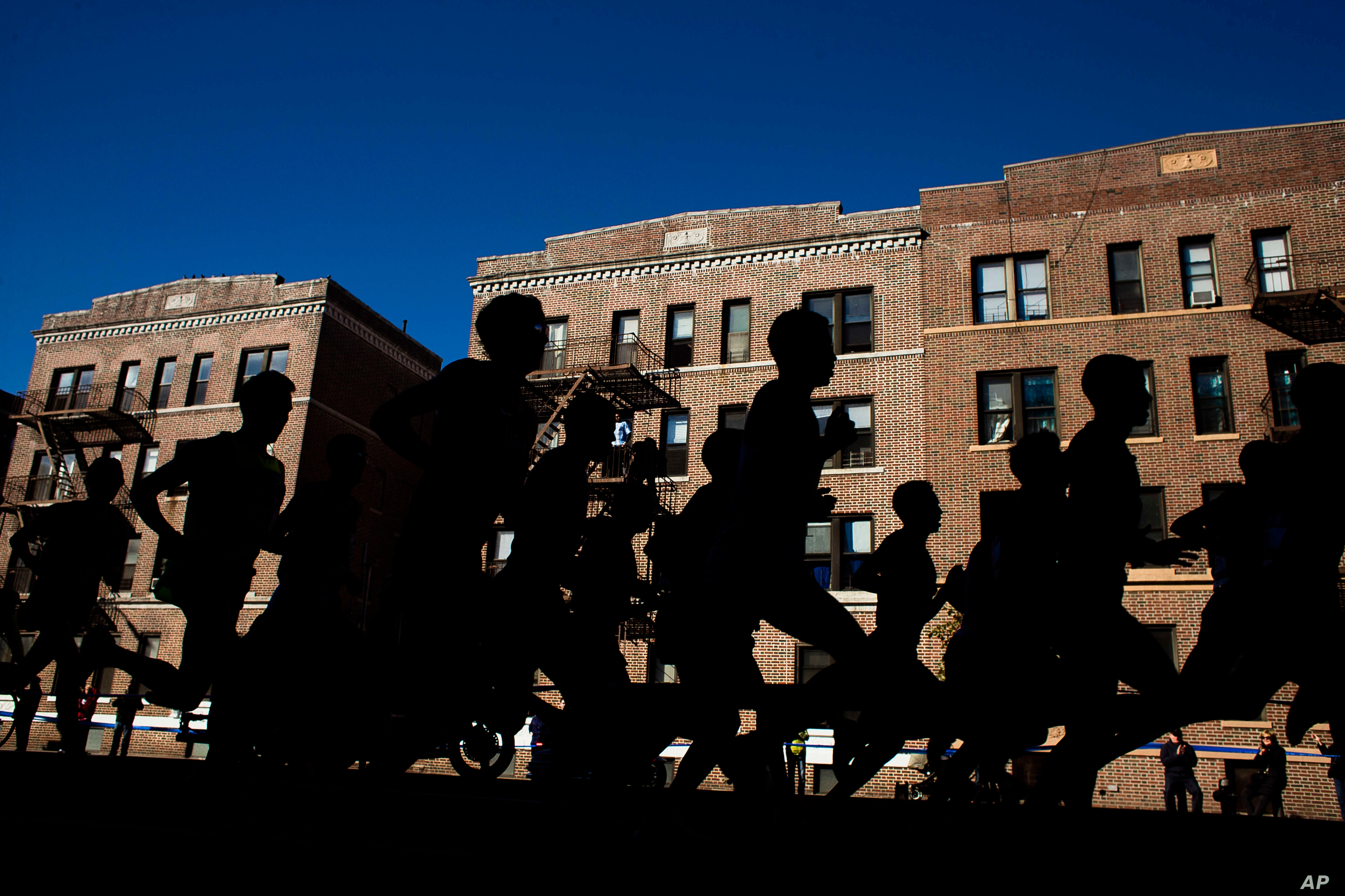 Runners move along 4th Avenue in the Brooklyn borough of New York during the New York City Marathon on Sunday, Nov. 6, 2016. Worrying about your health can be bad for your health ....