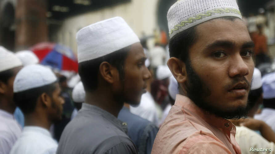 A student member of the Islamic Constitutional Movement attends an anti-India demonstration in front of the national mosque in Dhaka.