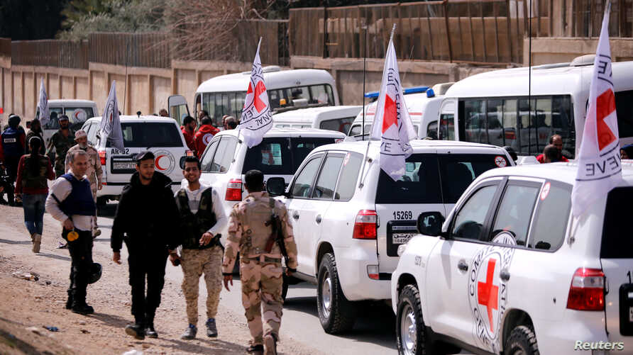 International Committee of the Red Cross (ICRC) convoy seen crossing into eastern Ghouta near Wafideen camp in Damascus, March 5, 2018.