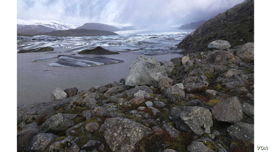A new landscape of lakes, scree slopes, hills and large boulders is revealed after a glacier retreats. Glaciers in Iceland—and throughout the Arctic—are vanishing due to a rapidly warming climate. 9Feo Pitcairn Fine Art)