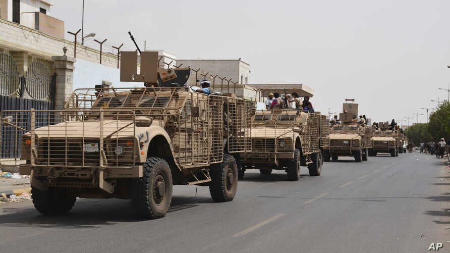Yemeni pro-goverment forces fighting Houthi rebels are seen riding military vehicles on a street in the port city of Aden, Yemen, July 14, 2015.