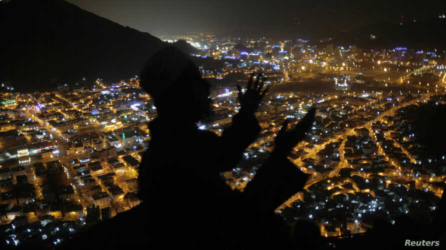 A Muslim pilgrim prays at Mount Al-Noor ahead of the annual haj pilgrimage in Mecca, Oct. 10, 2013.