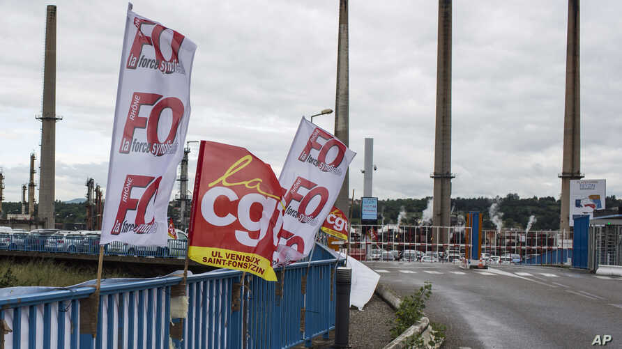 CGT and FO union flag flutter at the main entrance of the Feyzin refinery in background, near Lyon, central France, May 30, 2016.