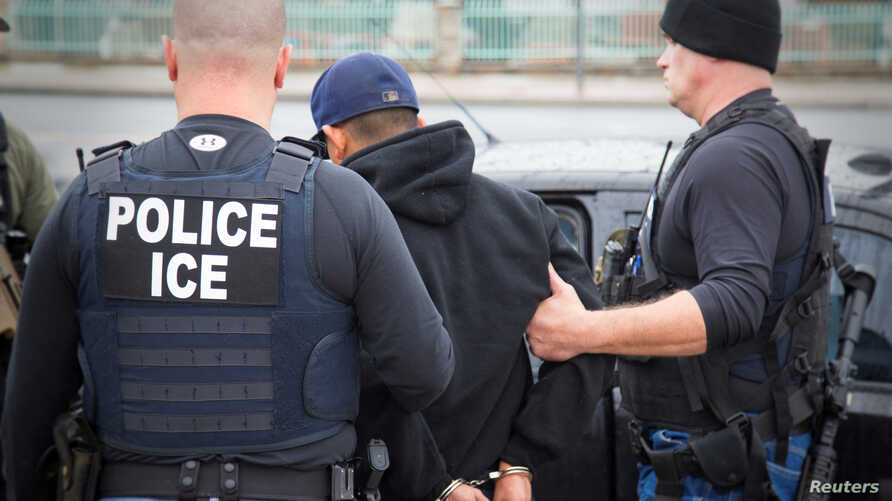 FILE - U.S. Immigration and Customs Enforcement (ICE) officers detain a suspect as they conduct a targeted enforcement operation in Los Angeles, Feb. 7, 2017.