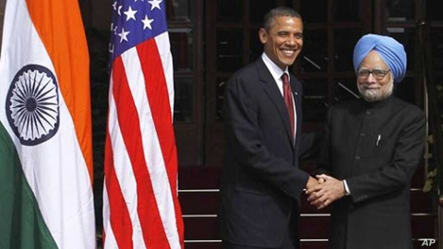 U.S. President Barack Obama, left, is received by Indian Prime Minister Manmohan Singh, as he arrives for bilateral talks at the Hyderabad House in New Delhi, India, 8 Nov. 2010.