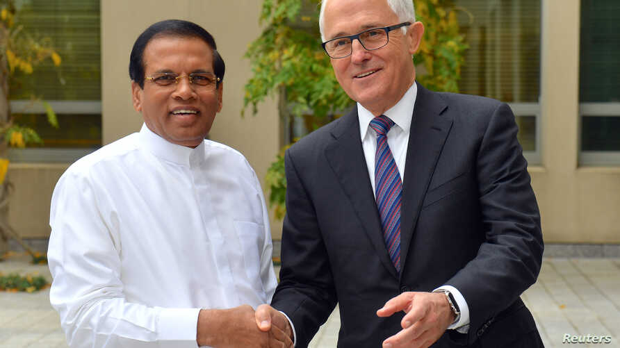 Australia's Prime Minister Malcolm Turnbull shakes hands with Sri Lanka's President Maithripala Sirisena at Parliament House in Canberra, Australia, May 25, 2017.