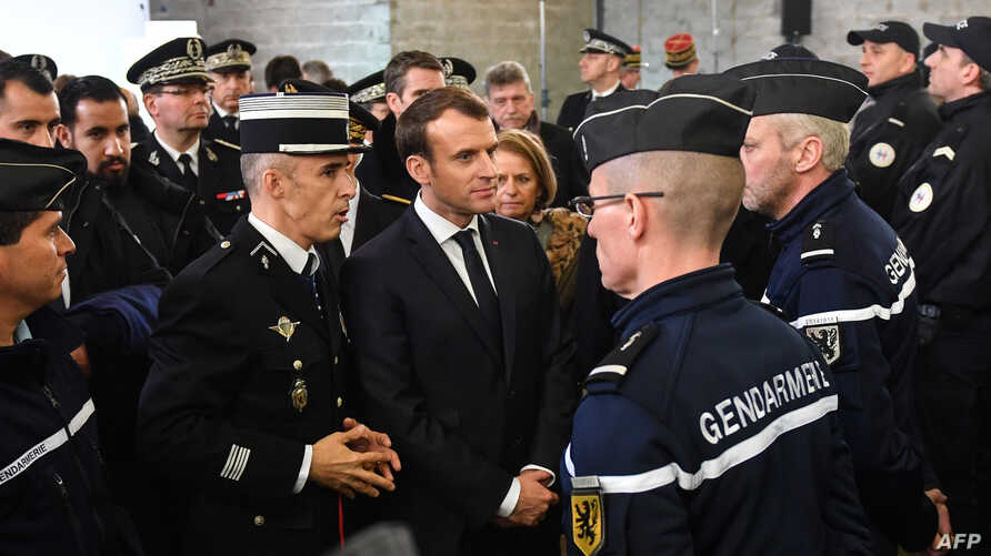 French President Emmanuel Macron (C) meets gendarmerie and police forces during his visit in the French northern city of Calais Jan. 16, 2018.