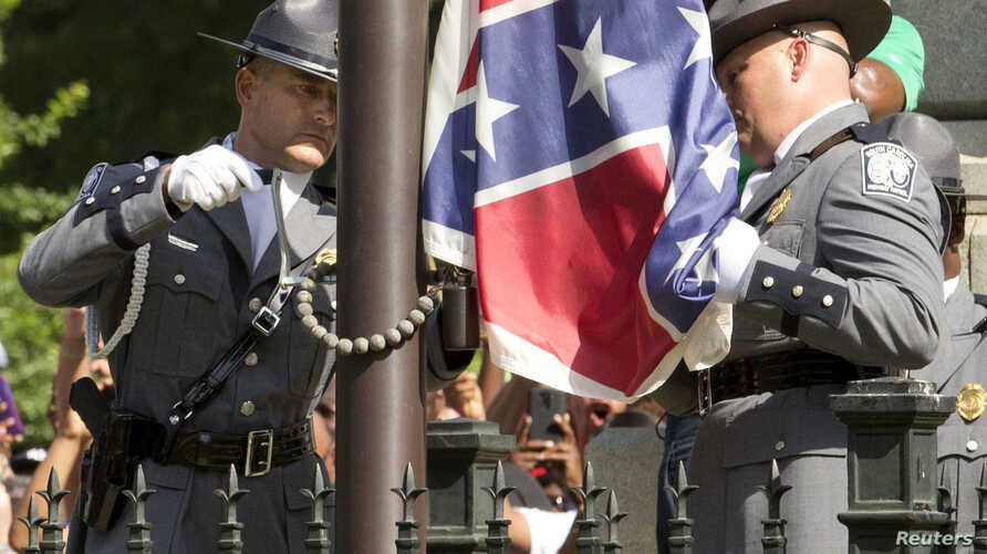 The Confederate battle flag is permanently removed from the South Carolina statehouse grounds during a ceremony in Columbia, South Carolina July, 10, 2015.