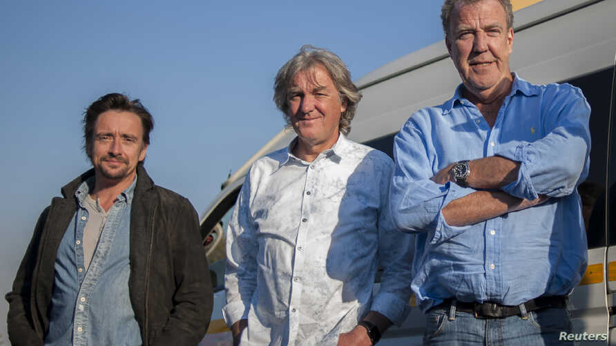 A picture taken on June 10, 2016 shows, from left, Richard Hammond, James May and Jeremy Clarkson posing at the Ticketpro Dome in Johannesburg, South Africa.