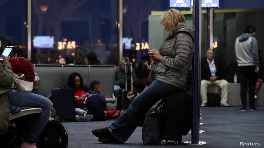 Passengers wait to board a delayed Southwest flight at Ronald Reagan Washington National Airport in Arlington, VA, U.S., April 1, 2019.