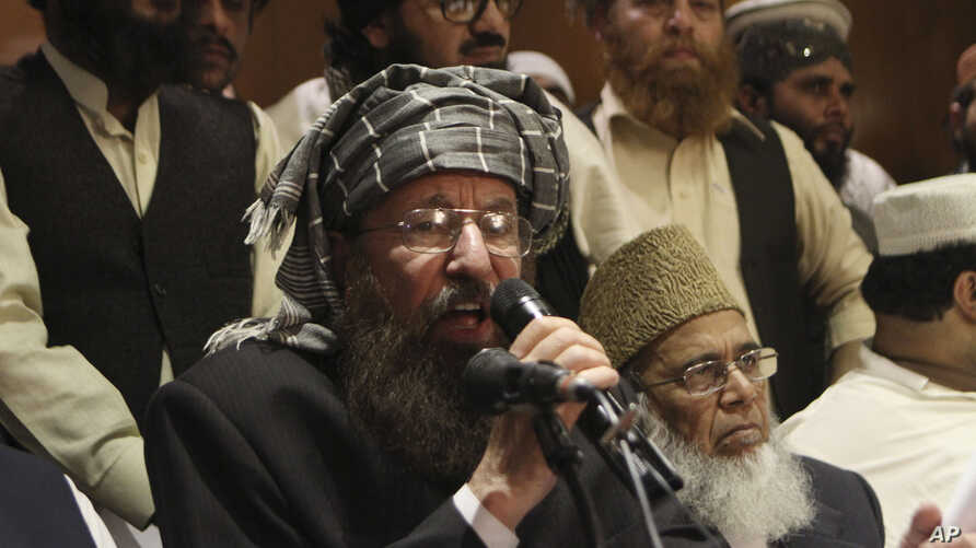 Pakistani religious cleric and member of Taliban's negotiating committee Maulana Sami-ul-Haq speaks during a press conference in Lahore, Pakistan, Feb. 15, 2014.