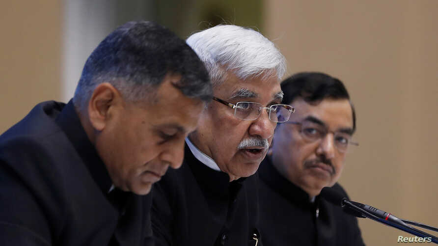 India's Chief Election Commissioner Sunil Arora (C) speaks as Election Commissioner Ashok Lavasa (L) and Sunil Chandra look on during a news conference in New Delhi, India, March 10, 2019.