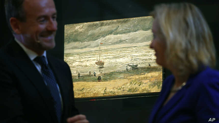 "Van Gogh Museum director Axel Rueger, left, and Jet Bussemaker, Minister for Education, Culture and Science, stand next to the stolen and recovered ""Seascape at Scheveningen"" by Dutch master Vincent van Gogh, during a press conference in Amsterdam, N"