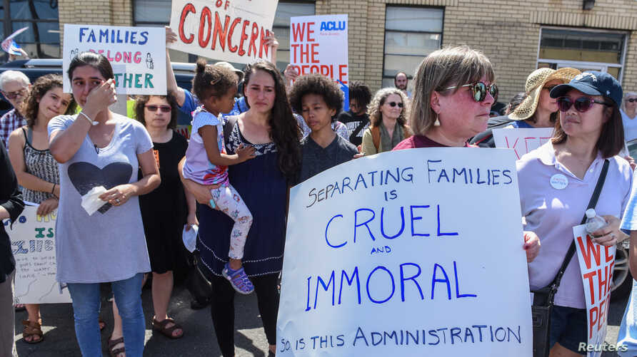 People participate in a protest against recent U.S. immigration policy that separates children from their families when they enter the United States as undocumented immigrants, in front of a Homeland Security facility in Elizabeth, New Jersey, June 1...