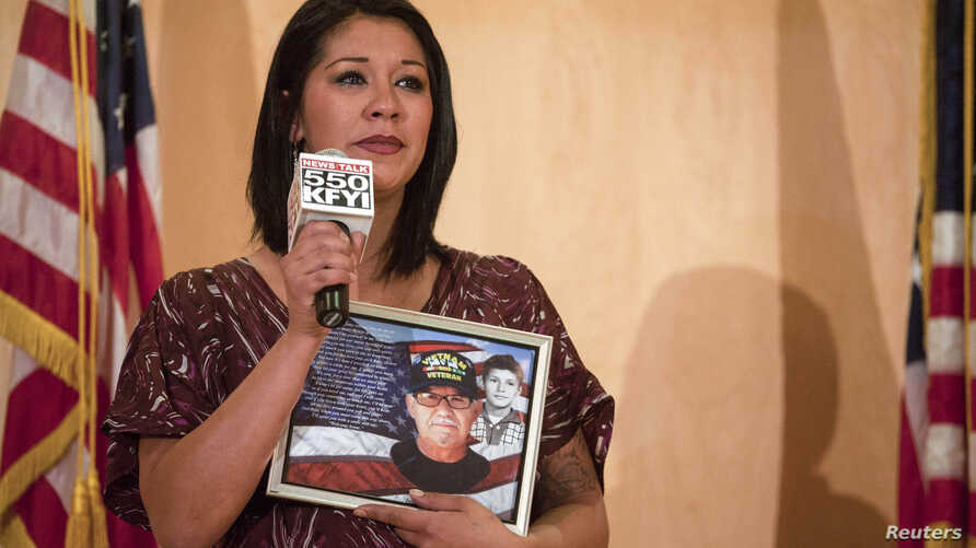 FILE - A woman speaks about her Vietnam veteran father at a community forum over recent allegations of gross mismanagement and neglect of veterans health care in Phoenix, Arizona May 9, 2014.