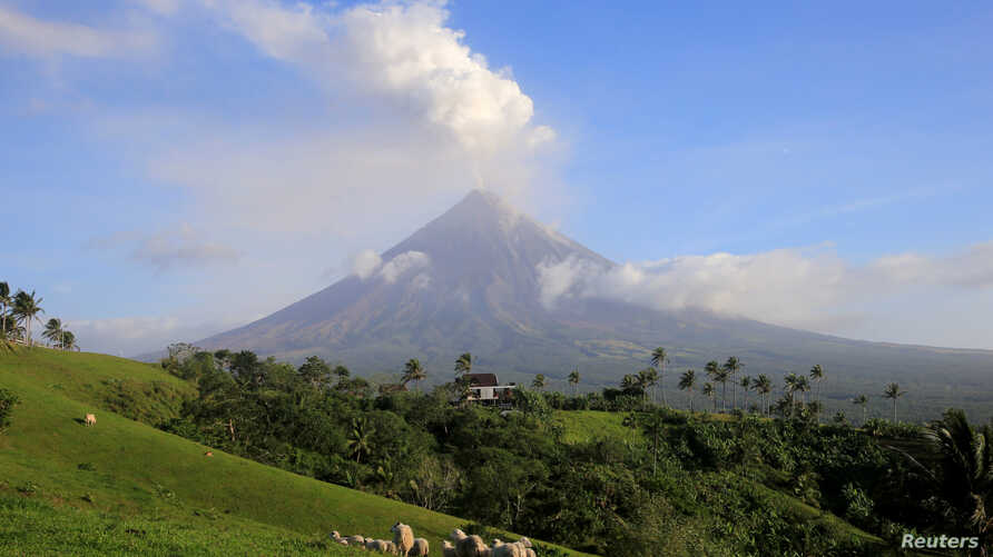 Volcanic ash spews out of a crater of Mount Mayon volcano during an eruption in Camalig, Albay province, south of Manila, Philippines Jan. 29, 2018.