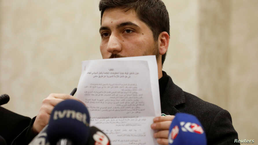 Osama Abu Zaid, a spokesman for the Free Syrian Army rebel alliance, shows the text of the agreement about a ceasefire between Syrian opposition groups and the Syrian government during a news conference in Ankara, Turkey, Dec. 29, 2016.