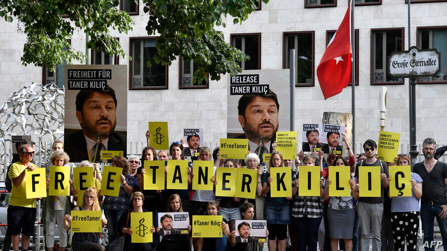 FILE - Activists of Amnesty International stage a protest against the detention of the head of Amnesty International in Turkey, Taner Kilic, in front of the Turkish Embassy in Berlin on June 15, 2017.