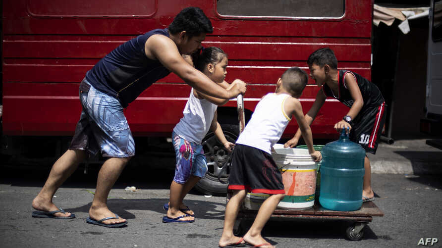 This photo taken on March 14, 2019 shows residents of Barangka, in Manila, gathering water.