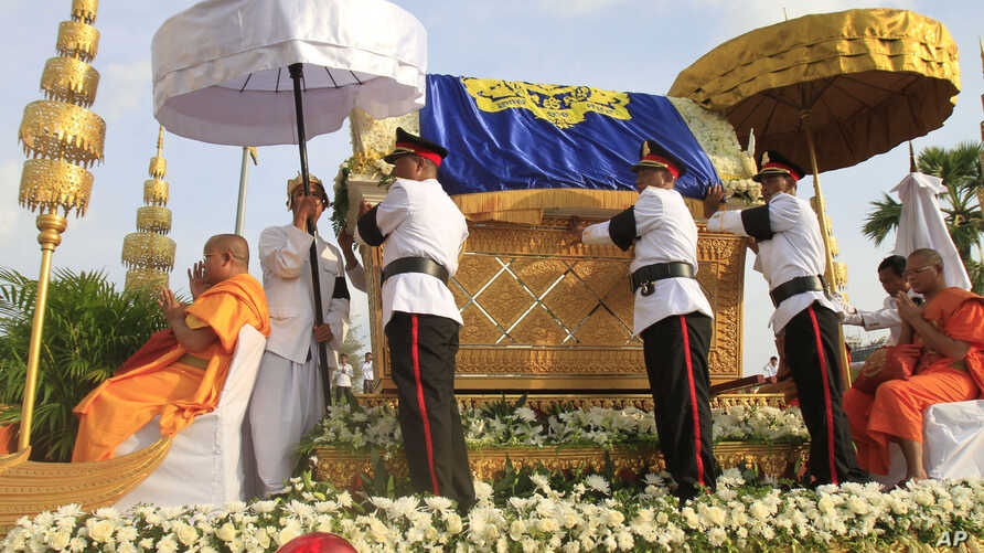 The casket containing the body of Cambodia's late King Norodom Sihanouk is carried by a flotilla of legendary phoenix in the procession on the street in Phnom Penh, Cambodia, Oct. 17, 2012.