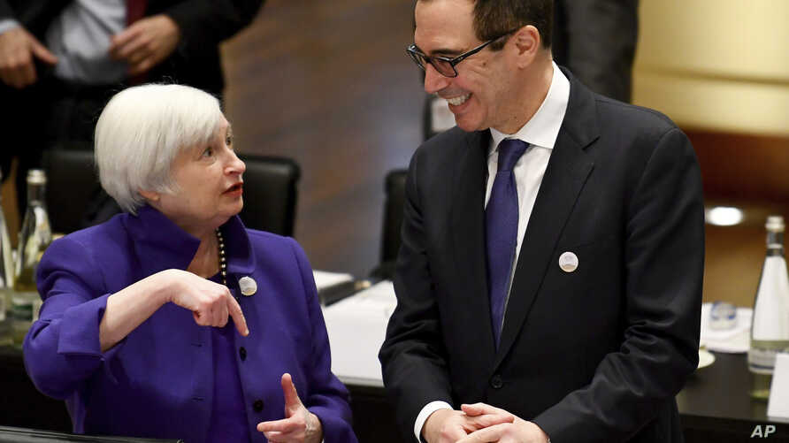 Janet Yellen, president of the Federal Reserve Board, and U.S. Treasury Secretary Steven Mnuchin talk to each other during the G20 finance ministers meeting in Baden-Baden, Germany, March 17, 2017.