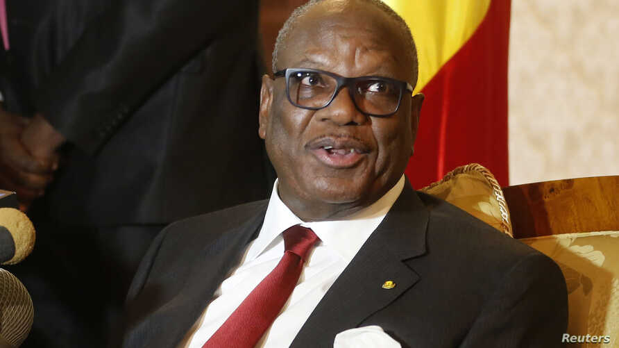 FILE - Mali's President Ibrahim Boubacar Keita answers a question upon his arrival at Algiers airport, Jan. 18, 2014.