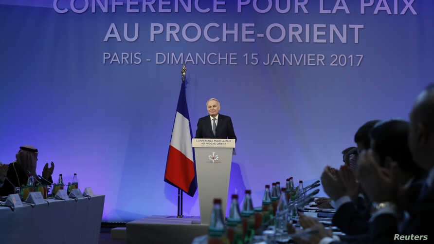 French Minister of Foreign Affairs Jean-Marc Ayrault addresses delegates at the opening of the Mideast peace conference in Paris, Jan. 15, 2017.Around 70 countries and international organizations are making a new push for a two-state solution in the