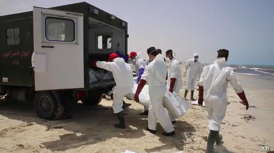 FILE - Emergency services remove one of more than 100 bodies pulled from the Mediterranean Sea after a smuggling boat carrying mainly African migrants sank, near the western city of Zwara, Libya, June 3, 2016.