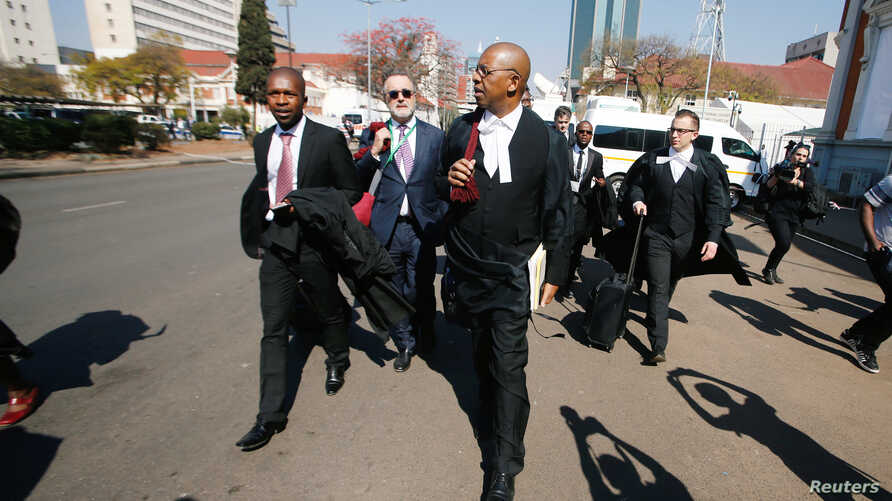 Lawyers representing opposition Movement for Democratic Change (MDC) leader Nelson Chamisa arrive at court to challenge President Emmerson Mnangagwa's election victory in Harare, Aug. 22, 2018.