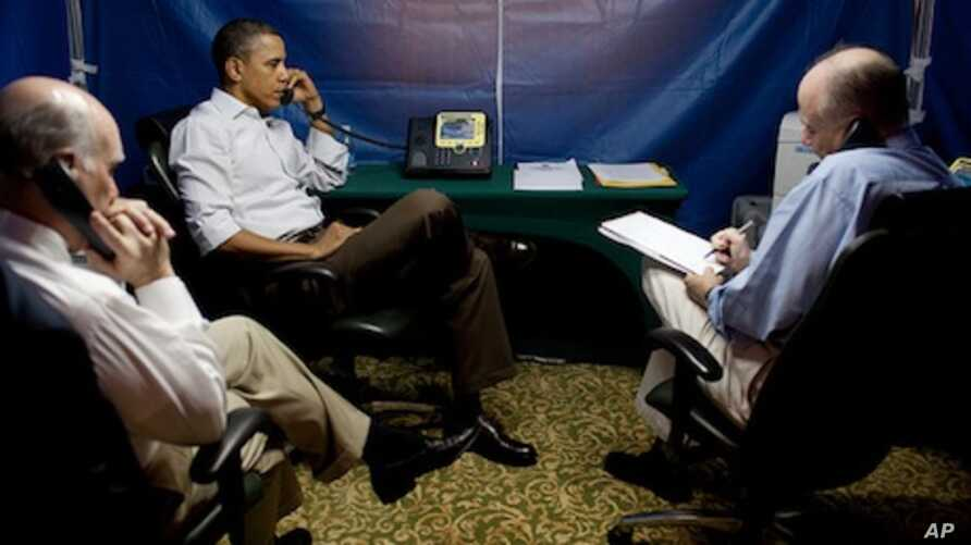 President Barack Obama is briefed on the situation in Libya during a secure conference call that included National Security Adviser Tom Donilon, right, and Chief of Staff Bill Daley, left.