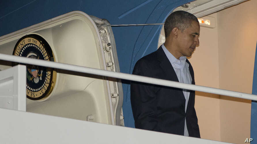 President Barack Obama boards Air Force One before his departure from Andrews Air Force Base, Sunday, March 23, 2014.