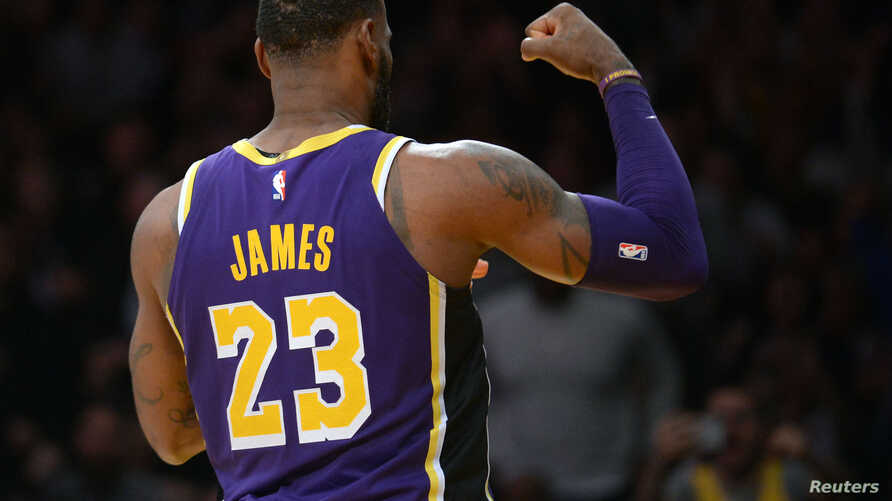 Los Angeles Lakers forward LeBron James (23) reacts after scoring a basket against the Denver Nuggets during the first half at Staples Center, March 6, 2019, in Los Angeles