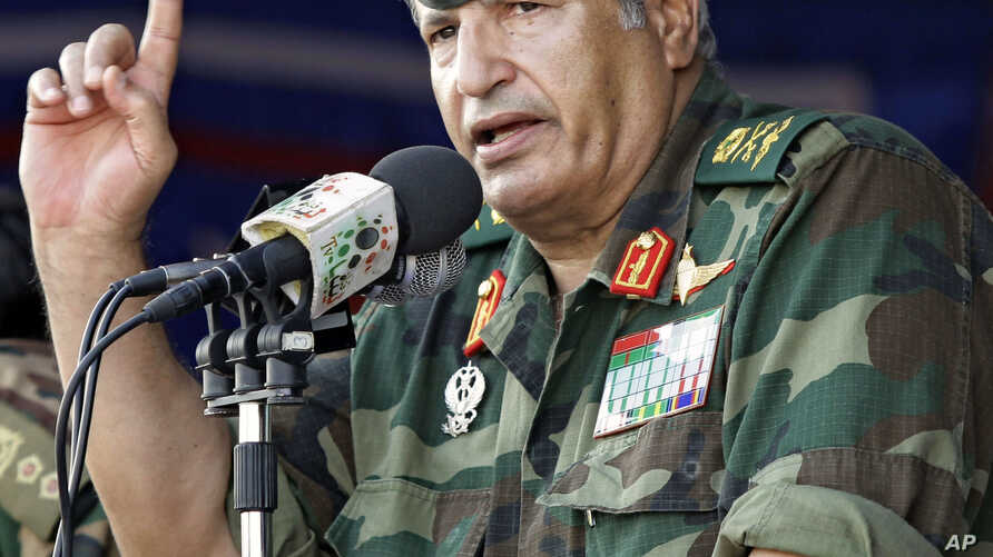 FILE - In this photo taken July 6, 2011, rebel forces chief commander Abdel Fattah Younes speaks during a rally in the rebel-held city of Benghazi, Libya.