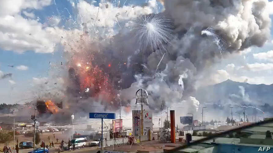 A massive explosion guts Mexico's biggest fireworks market in Tultepec, Dec. 20, 2016.