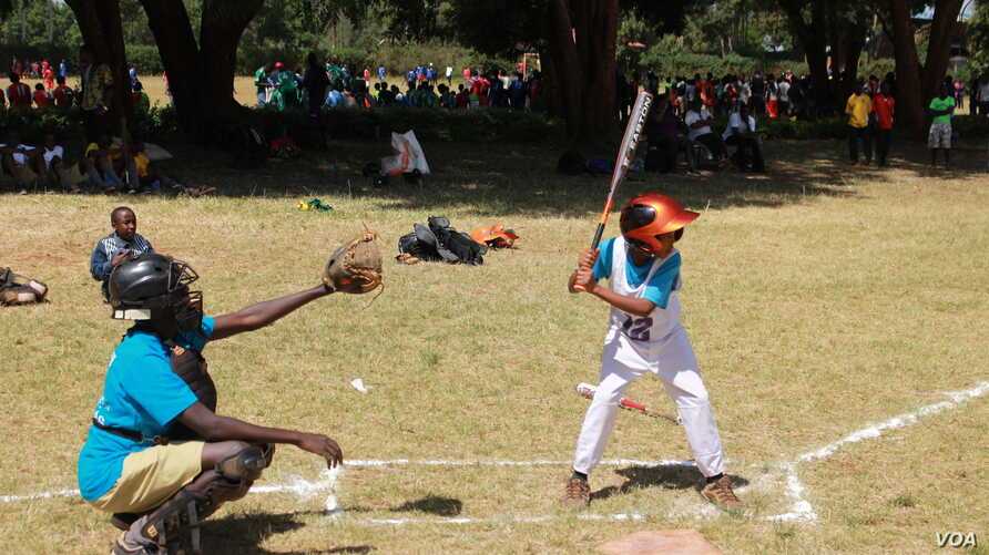 Kelly Lemaiyen, captain of the Kilimanjaro All-Stars, is one of the shortest members on the team, and one of the youngest at just 12, but he commands respect on the baseball diamond. (L. Ruvaga/VOA)