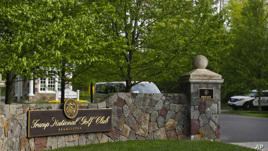 FILE - The entrance to Trump National Golf Club in Bedminster, N.J., is pictured May 7, 2017.