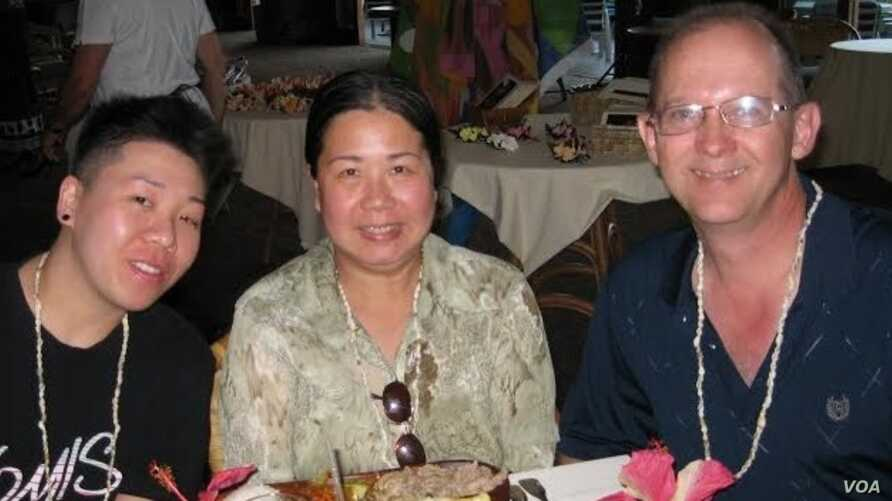 Sandy Phan Gillis (C) is seen in an undated and uncaptioned photo with her husband Jeff Gillis. (Courtesy - SaveSandy.org)
