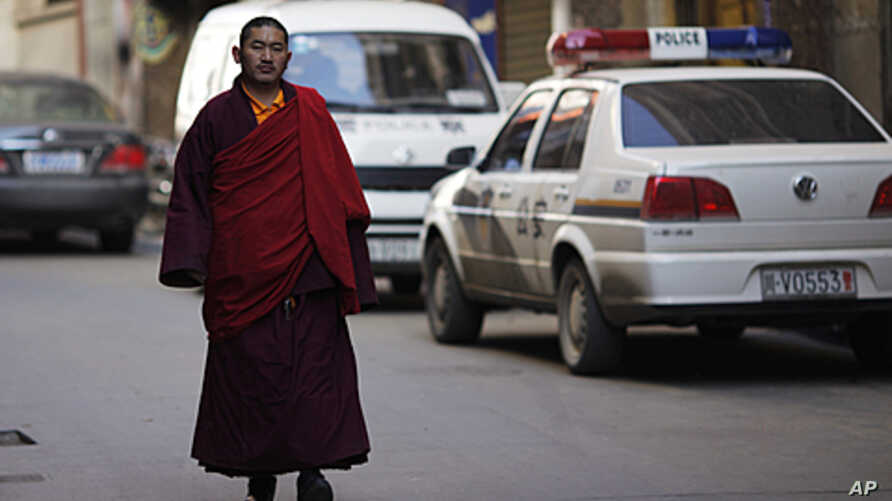An ethnic Tibetan monk walks past a police station in Danba, Sichuan province. Ethnic tension simmered in remote corners of China's southwestern Sichuan province after security forces fired on demonstrators in a series of deadly clashes that Tibet's