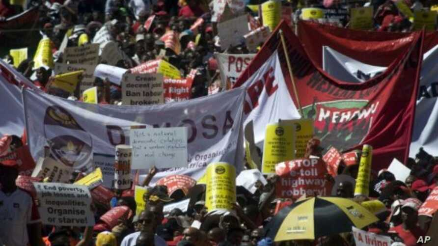 Thousands march through Cape Town in a protest by the powerful COSATU labor body, marking the latest sign of tensions within the ANC-led government, March 7, 2012.
