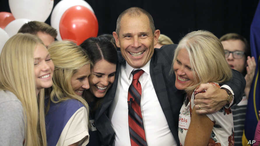 Provo Mayor John Curtis celebrates with his family after winning Utah's Republican primary to fill the U.S. House seat vacated by Jason Chaffetz, Aug. 15, 2017, in Provo, Utah.