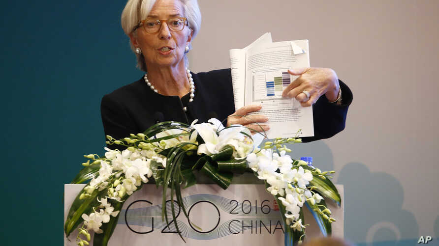 International Monetary Fund (IMF) Managing Director Christine Lagarde holds a document report while speaking during a session of the G20 High-Level Seminar on Structural Reform, proceeding the G20 Finance Ministers and Central Bank Governors Meeting