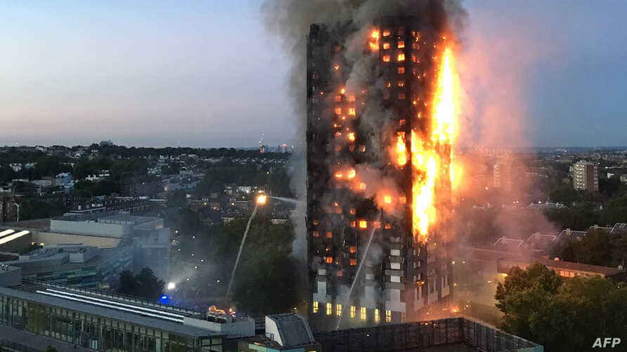 This handout image received by local resident Natalie Oxford early on June 14, 2017 shows flames and smoke coming from a 27-storey block of flats after a fire broke out in west London.