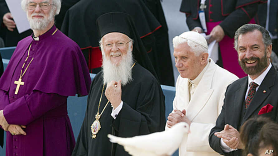 From left, Canterbury Archbishop Rowan Douglas Williams, Ecumenical Patriarch Bartholomew I, Pope Benedict XVI  and Rabbi David Rosen look on as a person holds a dove released during a peace meeting in front of the St. Francis Basilica in Assisi, cen