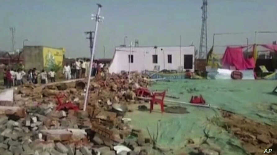 This image from video provided by KK Productions shows debris at the site of an accident in Bharatpur District, about 200 kilometers (125 miles) south of New Delhi, India, May 11, 2017. A building wall collapsed onto guests at a wedding in western In
