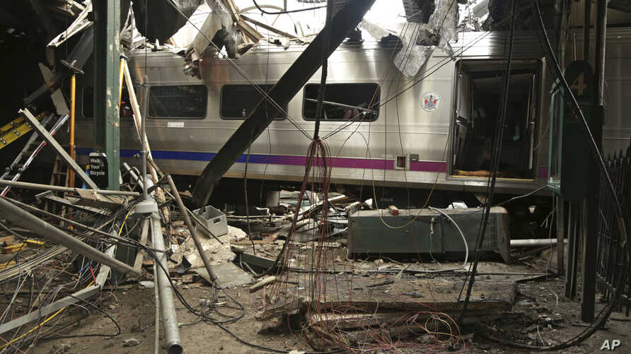 FILE - This photo provided by the National Transportation Safety Board on Oct. 1, 2016, shows damage done to the Hoboken Terminal in Hoboken, N.J., after a commuter train crash.