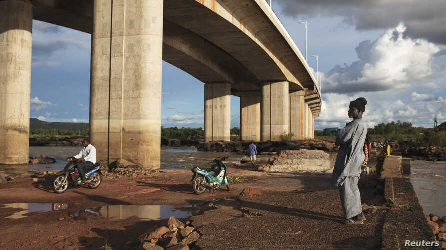 The China Gezhouba (Group) Corporation completed this bridge in Bamako, Mali, in 2011, one of many engineering projects conducted in Africa to realize the 'Chinese Dream'.