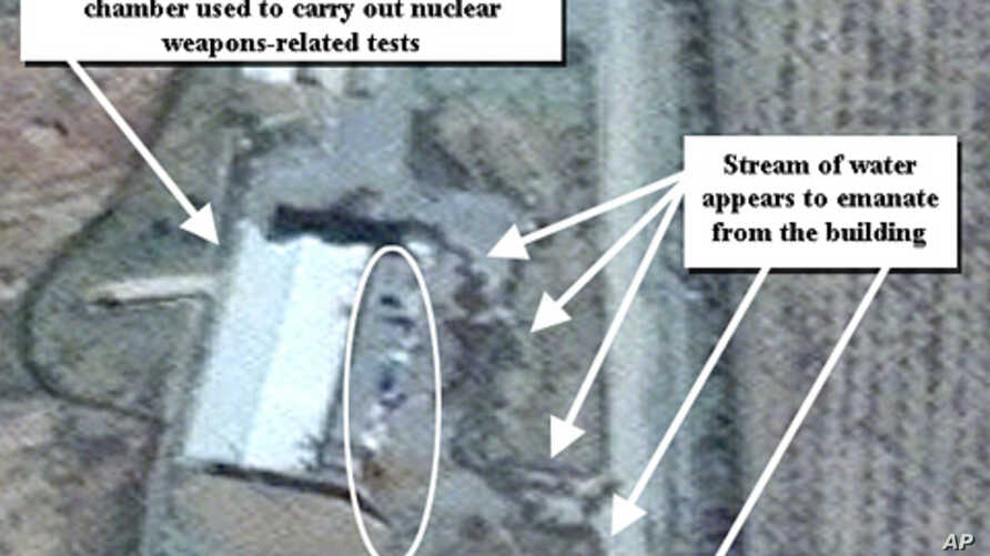 April 9, 2012 photo provided by the Institute for Science and International Security, shows suspected cleanup activities at a building alleged to contain a high explosive chamber used for nuclear weapon related tests in the Parchin military complex i