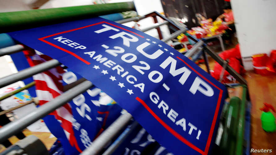 "FILE - Flags for U.S. President Donald Trump's ""Keep America Great!"" 2020 re-election campaign are seen at Jiahao flag factory in Fuyang, Anhui province, China July 24, 2018."